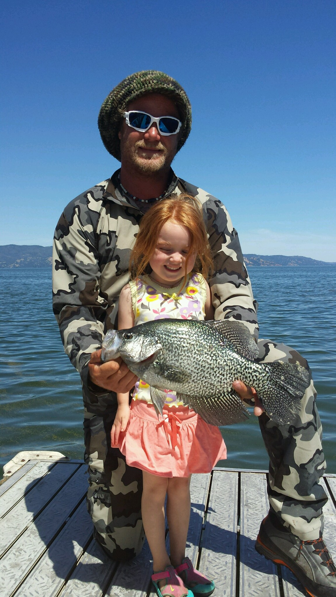 """Nate and Daughter """"Baby G"""" with a beautiful Clearlake Crappie.  Mike's Fishing Guide Service for Northern California salmon fishing guided adventures, and Sacramento River Fishing Guides.Targeting Sacramento River Salmon, Sacramento River Striped Bass, White Sturgeon on the Sacramento River, American Shad And Rainbow Trout, The Best Sacramento River Fishing Guide and Sacramento River Salmon and Striped Bass Fishing Guide On The Sacramento River. Sacramento River Fishing is our specialty."""