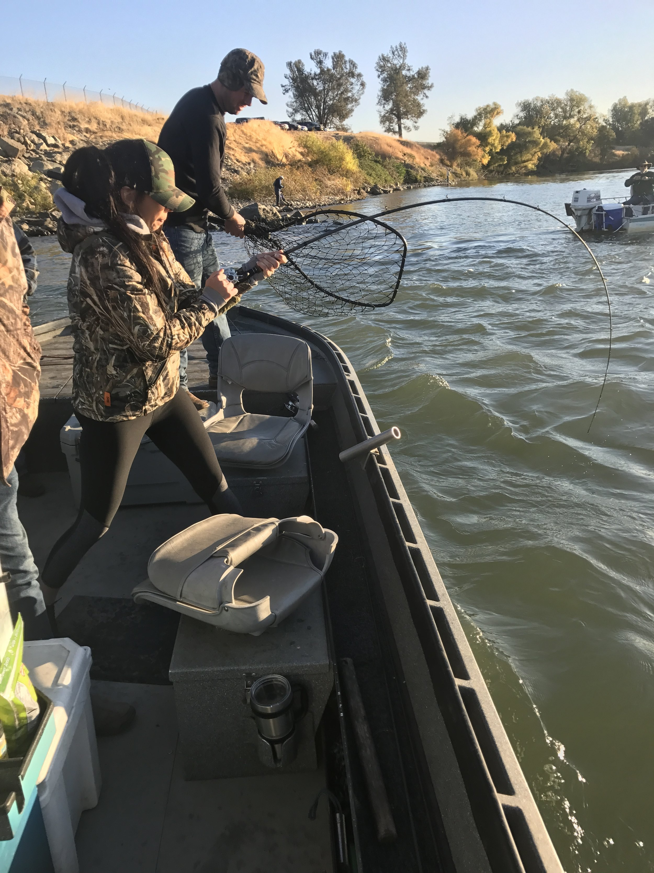 Jason Clack from Corning, Ca prepares to net a salmon that is being fought by Erica who hooked her salmon on a sardine wrapped Flatfish while fishing with Mike Rasmussen of Mike's Guide Service.