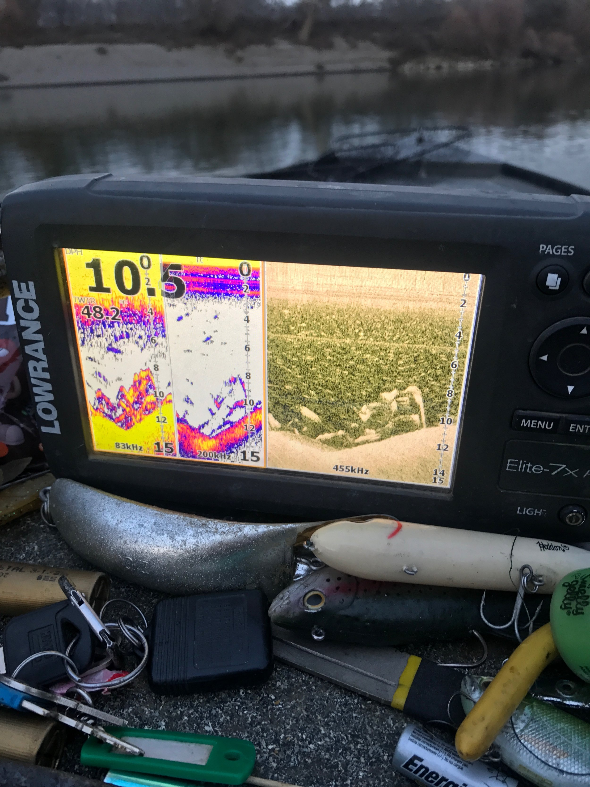 Fishing guide Mike Rasmussen takes a photo of his Lowrance fish finder as a dozen quality striped bass appear on the screen.