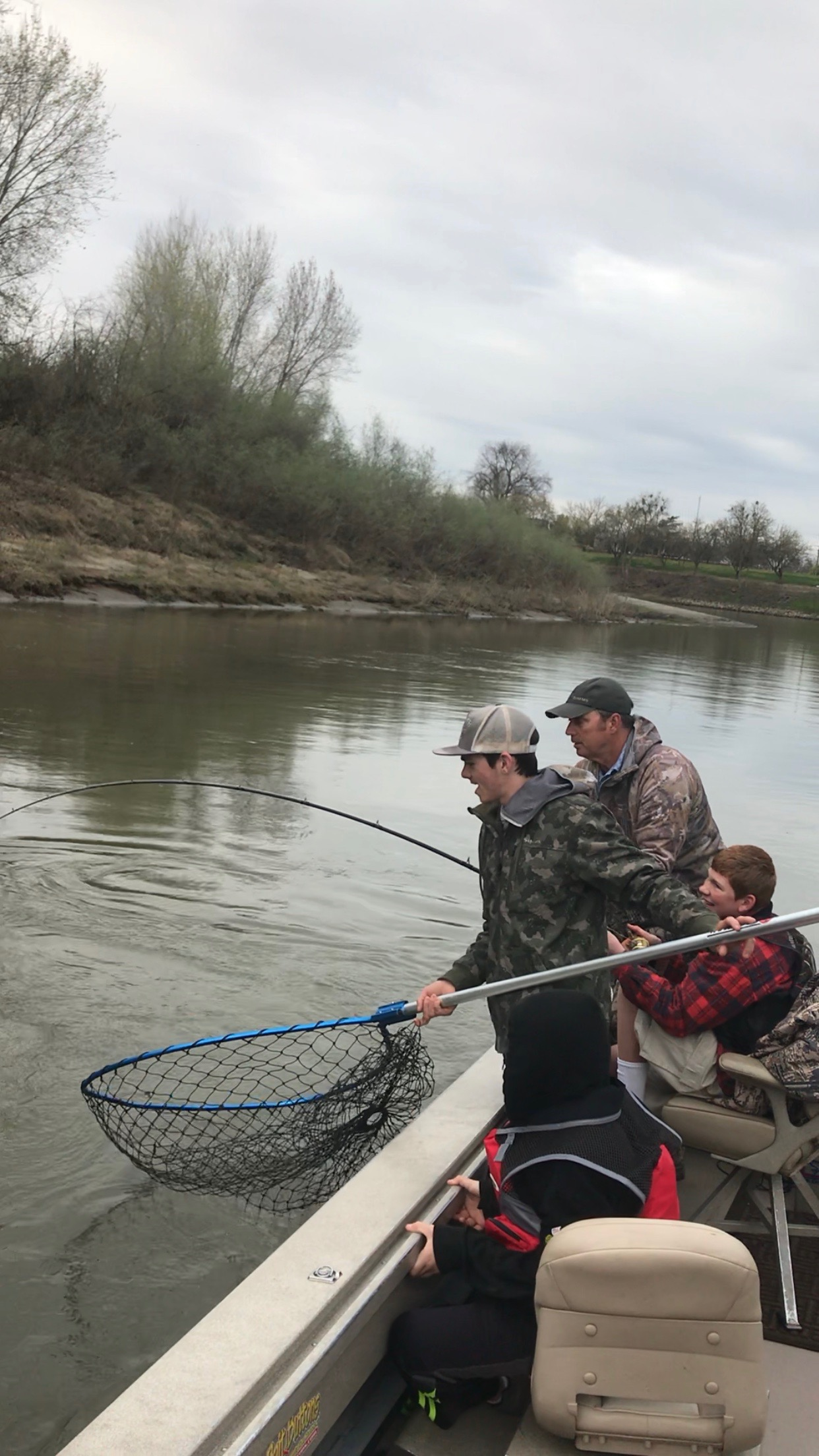 "Dave Jacobs keeping his eye on the prize, as his 13 year old guest fights a Sacramento River white sturgeon for the first time. Ryan Tripp successfully netted this 60"" sturgeon. It was released unharmed."