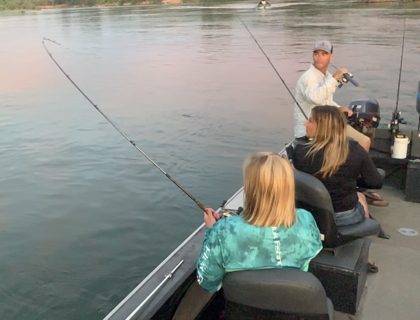 Salmon fishing guide John Pearl watches on as one of his guest hooks up on a dime bright King Salmon opening morning. The group was fishing on the Sacramento River near Los Molinos, Ca.