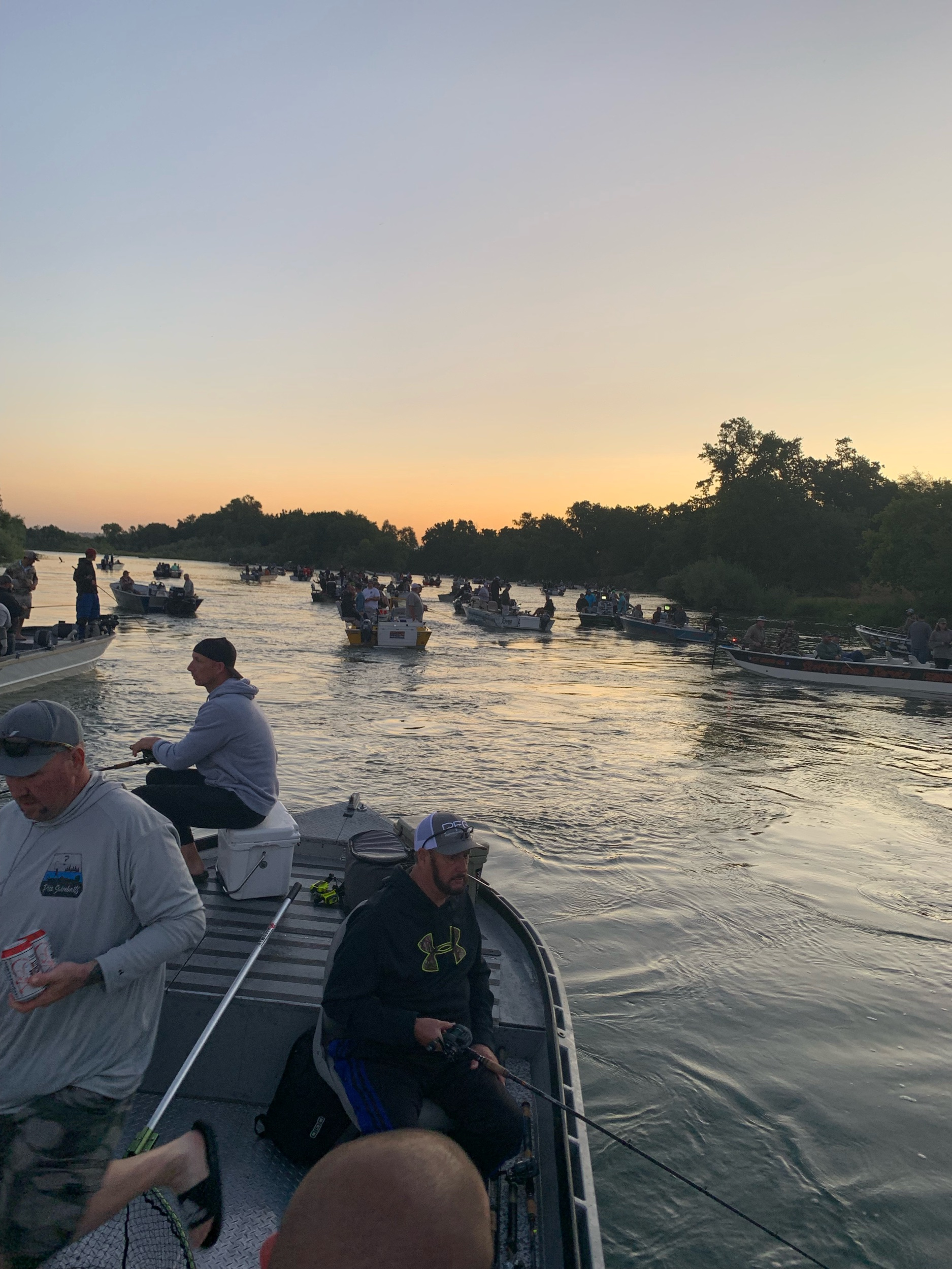 Opening morning at the Barge Hole prior to sunrise. Salmon fishing guide Mike Rasmussen snaps a shot of the action taking place on the Sacramento River.