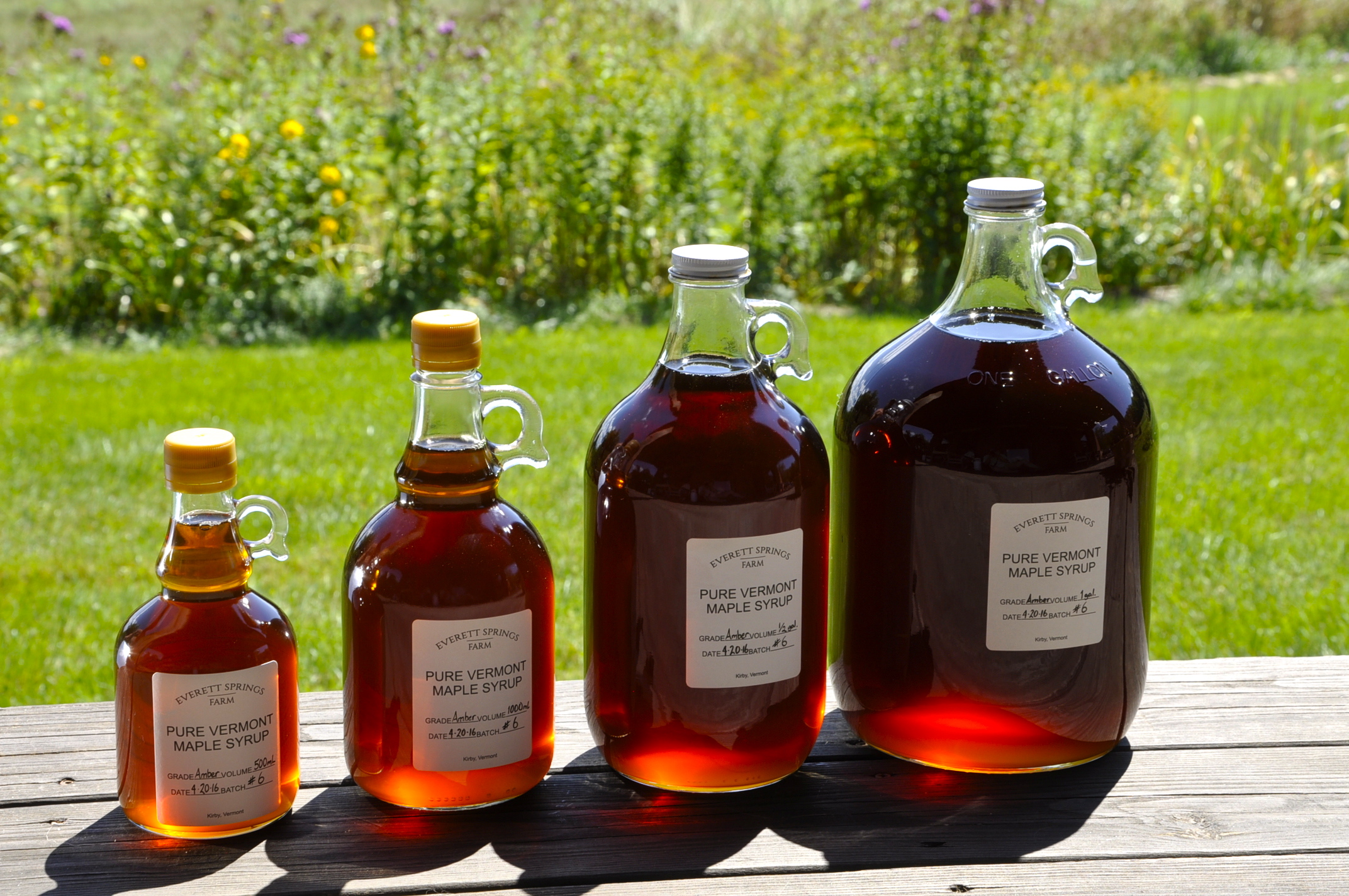 "Our sugar maples yield sap that process into three grades of syrup: Golden Delicate; Grade Amber Color - Rich Taste and Grade A Dark - Robust Taste. Though syrup in each bottle above may appear to vary by color, but all four bottles contain ""Amber Color - Rich Taste"". The syrup in the varying-sized bottles catches light according to its depth. Every season varies according to the whim of the sugar maples and all the imaginable natural variables."