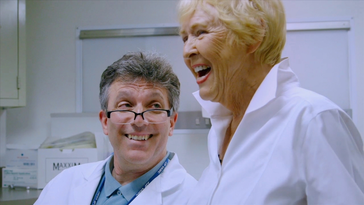 """Director Jean Carper gets the results of her brain Pet scan from Dr. Sam Gandy, Mount Sinai, New York. (Screenshot from """"Monster in the Mind,"""" Carper, J. Producer, 2017)"""