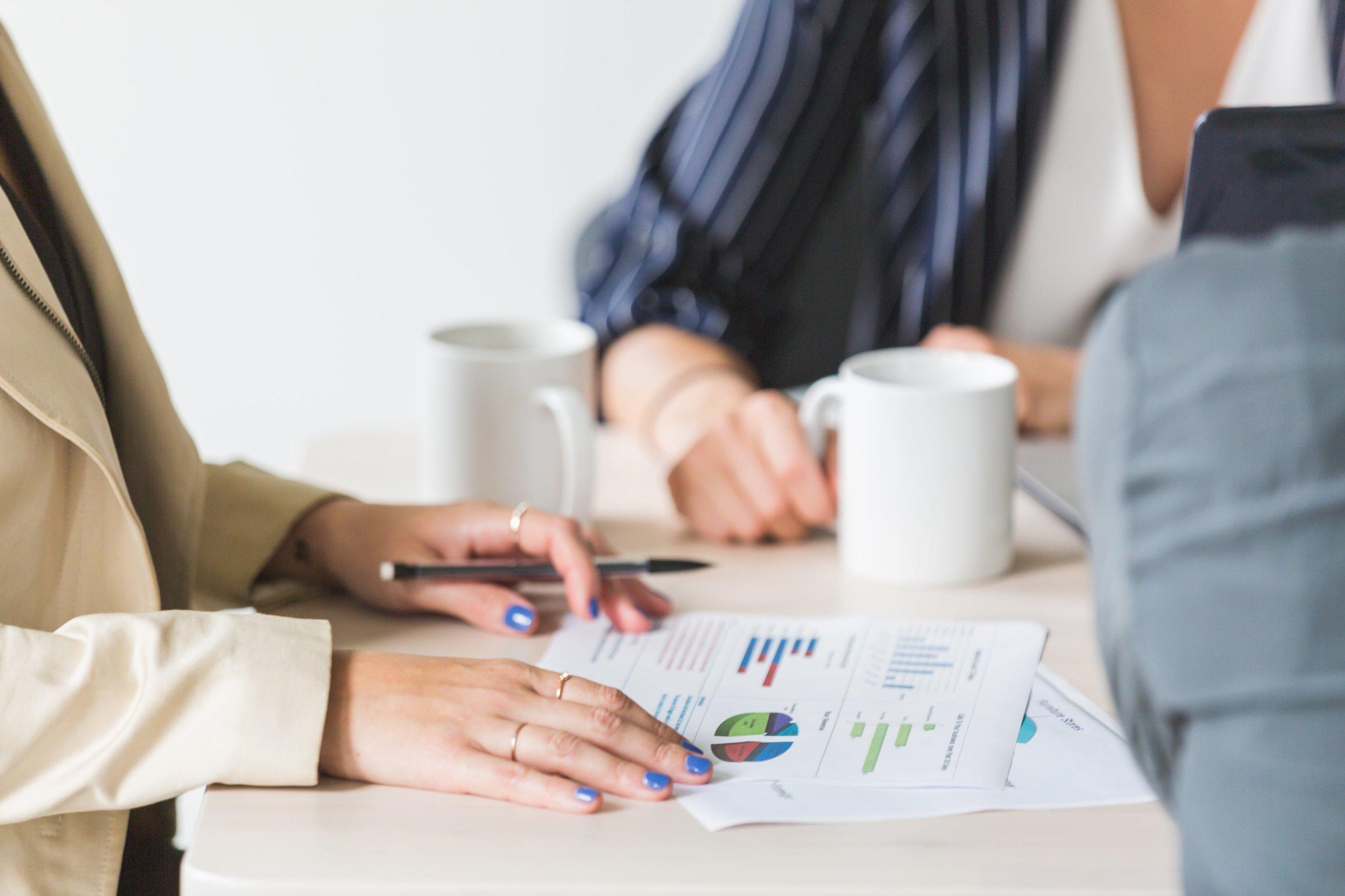 reading-charts-at-business-meeting_4460x4460.jpg