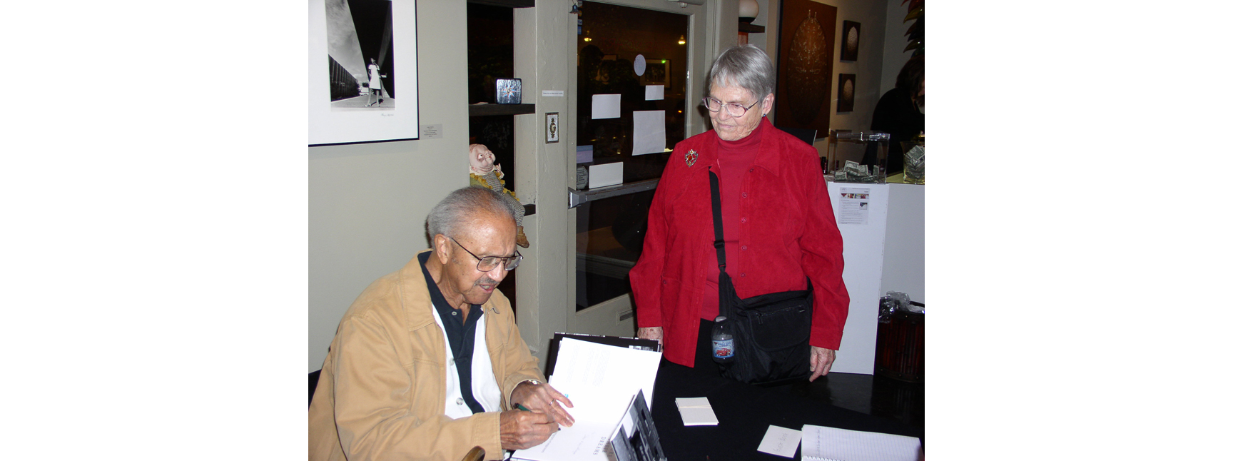 "Book signing.  ""Urbana"" show at  Distinction Gallery . December 2011."