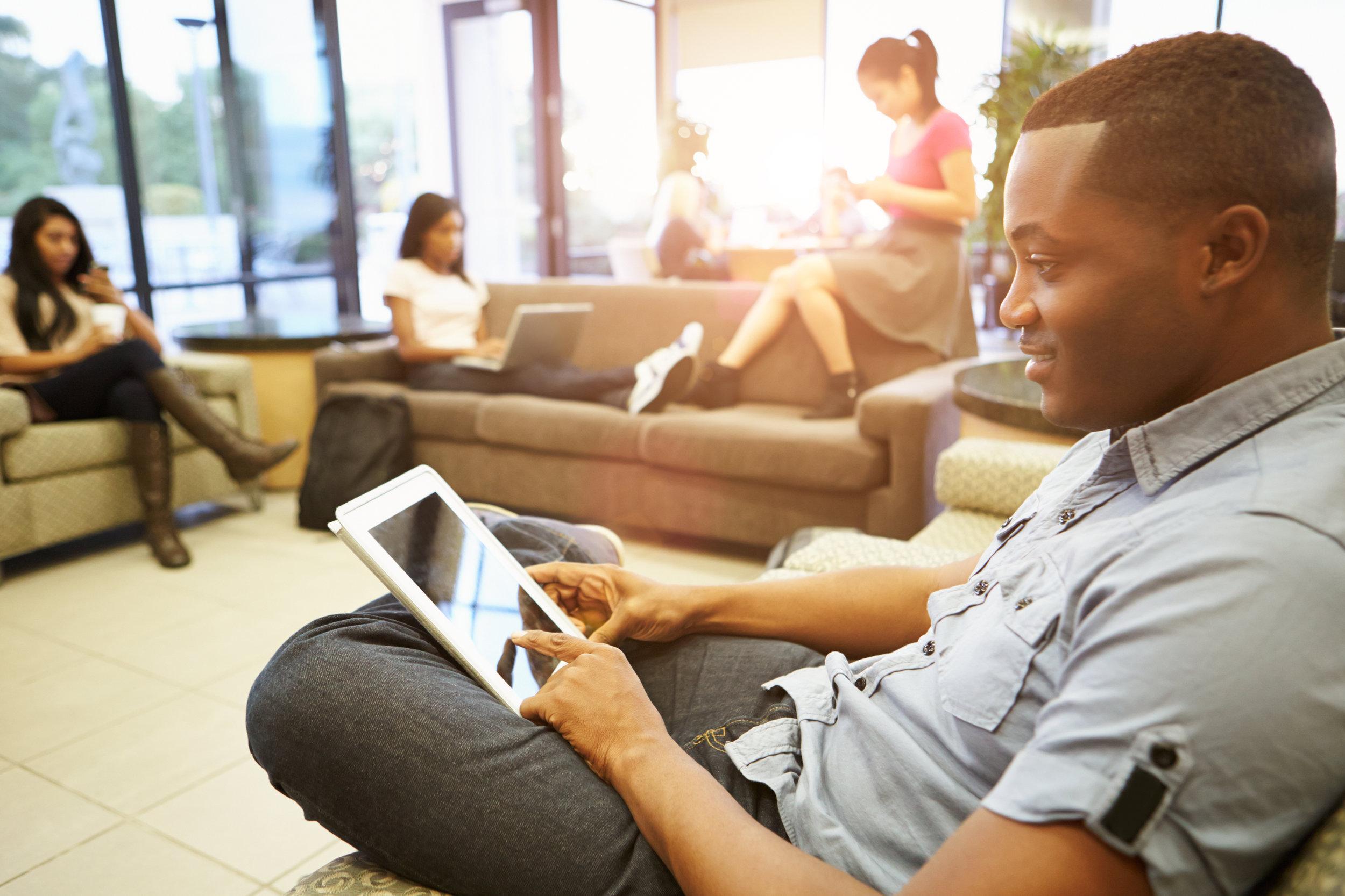 Black man on laptop in coworking space.jpg