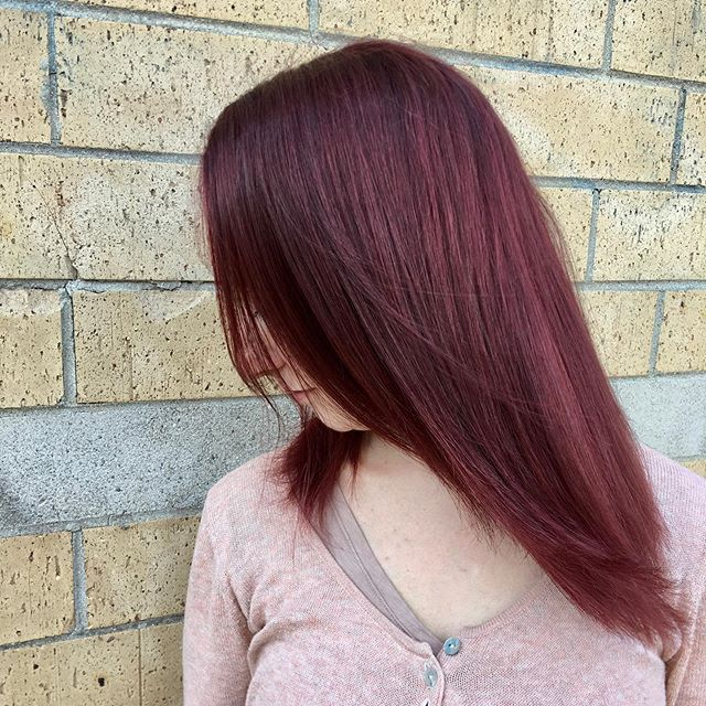 Beautiful Burgundy 🍷 . This beauty wanted a noticeable change in her daily look, so she went from an ashy curly style to a deep burgundy, smooth straightened style! Cut and color done by our top stylist Rhuby! . Appointments available this weekend- call 773.248.1114 or book online @streetsoflondonsalon.com . #redhair #curlyhair #straighthair #change #streetsoflondonsalon #chicago