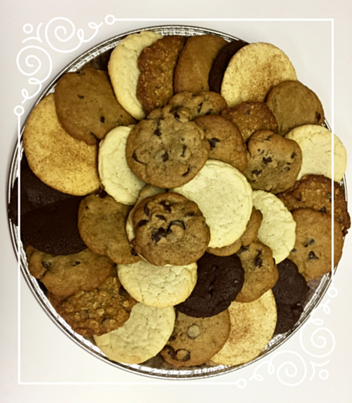 When you really need a lot of cookies... - We offer gorgeous (and of course yummy!) cookie trays that are perfect for your next meeting, party, play, dance performance, recital, study break, symposium, etc.We can also bring over lots of milk to go with all those cookies. Just let us know.Large orders can be delivered any time from 10 am until 12 am. Please give us at least 24 hours to create orders of over 25 cookies.To order or to discuss pricing for large orders, either click here, send us an email here, or give us a call at 603-COO-KIES. To order online, click here.If you are ordering for a non-profit organization, please put your tax id number in the comments section and order from the non-profit organization selections.Enjoy!