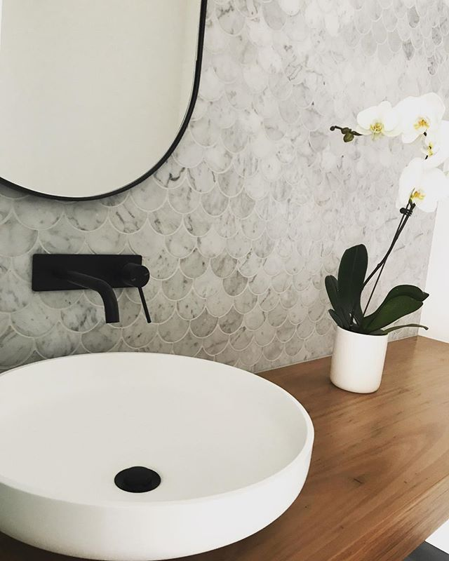 And just like that we received a stunning photo of our baby Carrara fish scale! @nncollective thank you ❤️ #interiordesign #carrara #powderroom