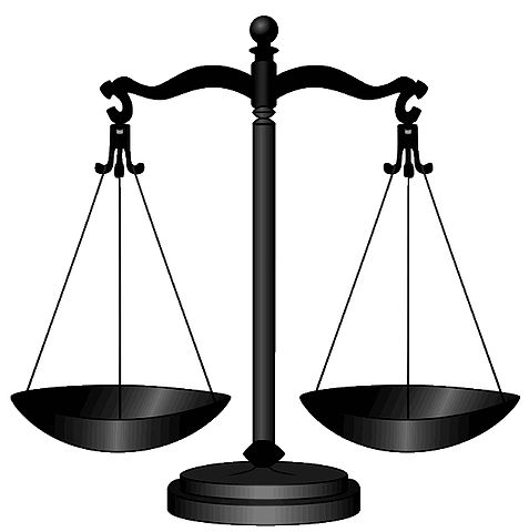13629138-Gold-scales-of-justice-isolated-on-white-background-Stock-Photo.jpg