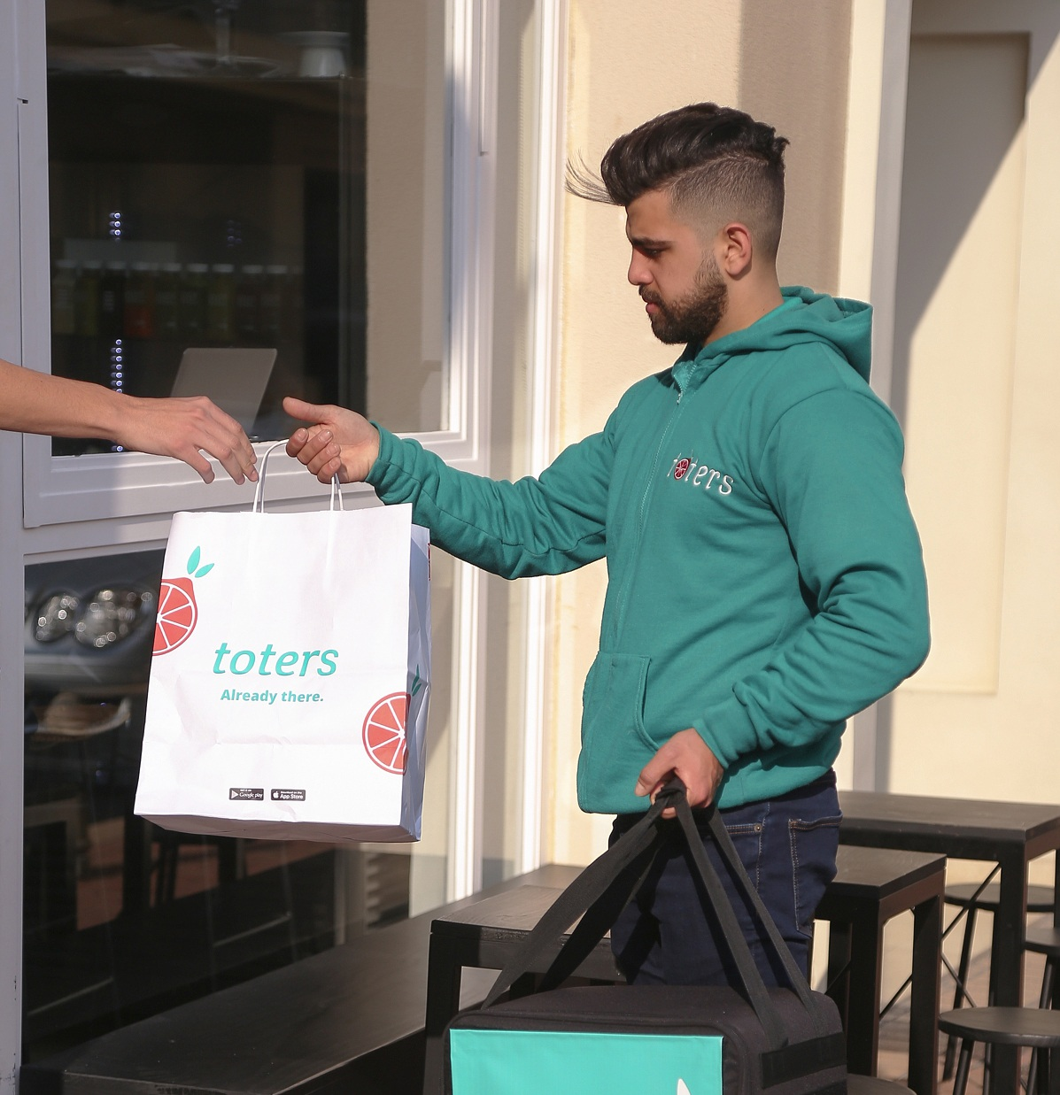 """Delivering with Toters has given me access to big opportunities and an amazing support system. - Ahmad H."