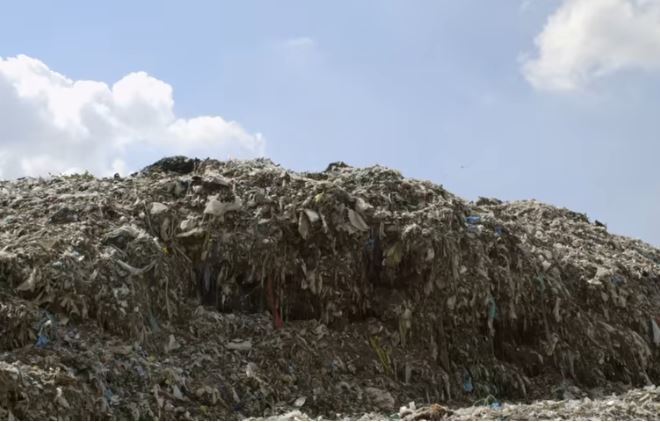 Image of Textile Waste taken from film still of The True Cost