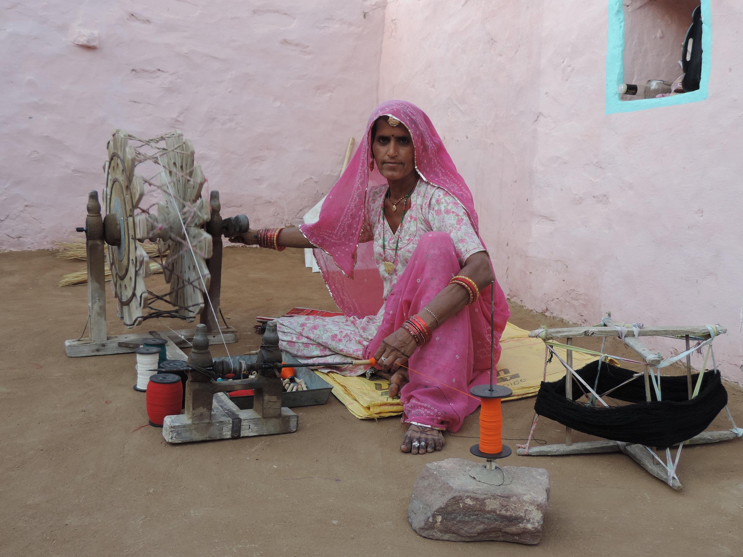 Nijra spinning yarn using a traditional Charkha