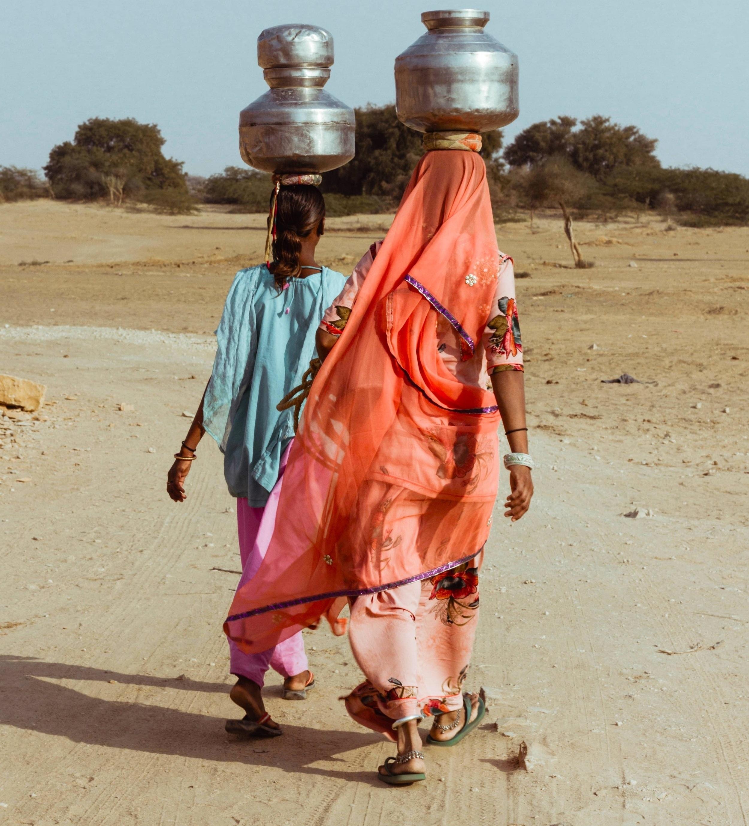 Rajasthani women carrying water pots