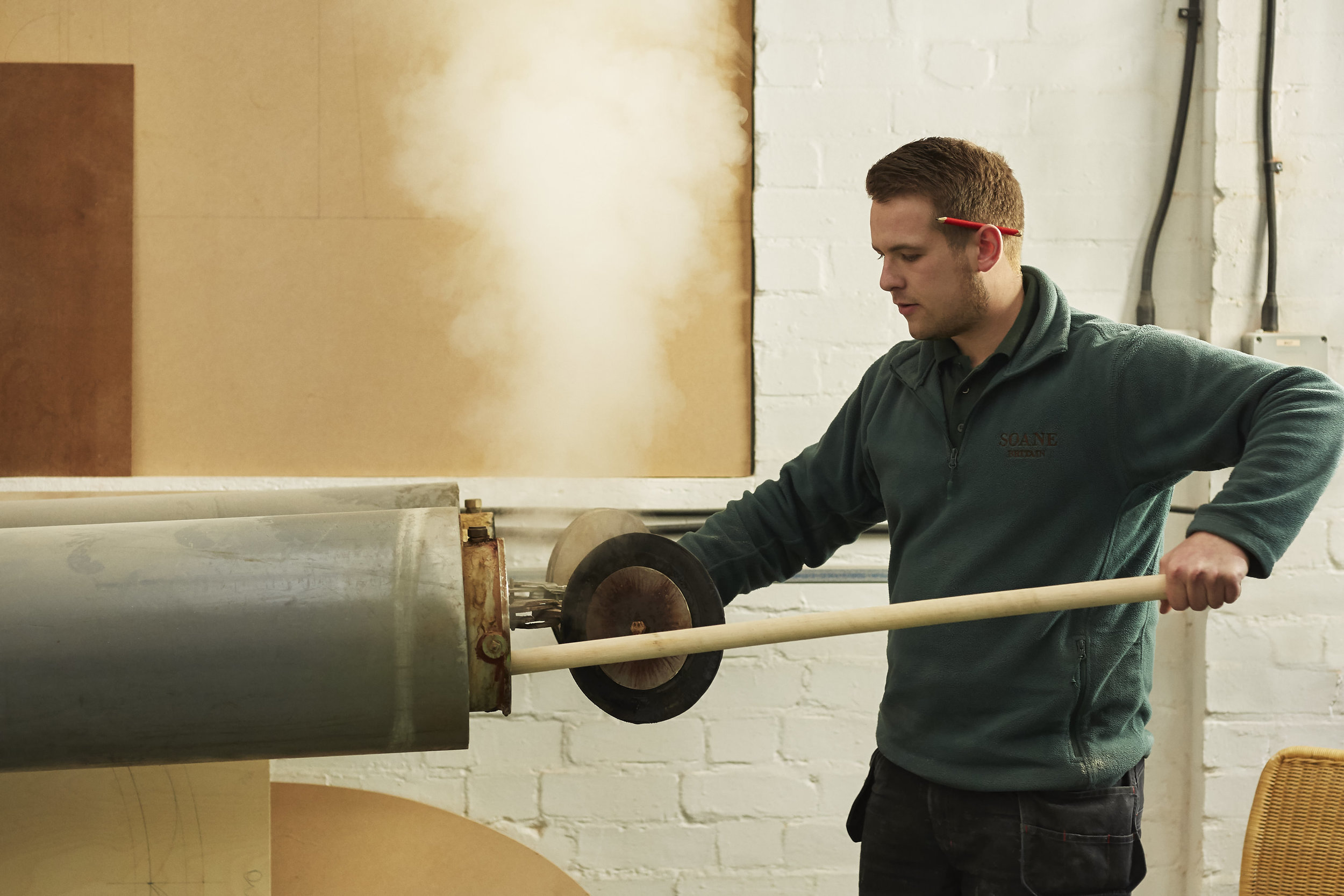 portrait-of-craftsman-steaming-timber