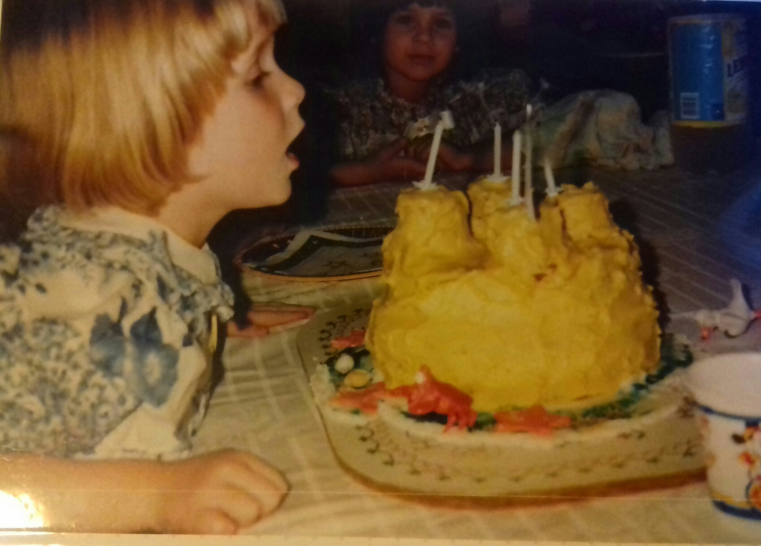 Blowing out the candles on one of the birthday cakes Carol made