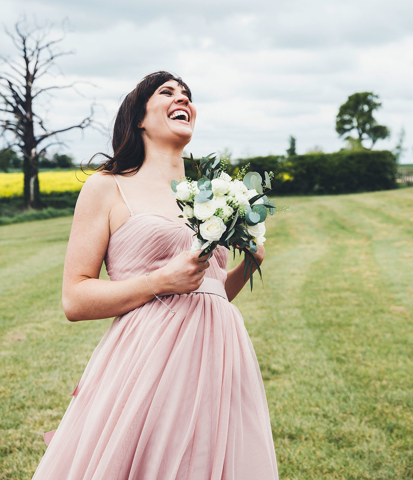 All the lols for Laura's bridesmaid Gill, wearing our  Bardot in smoked blush  in the spaghetti strap version. Photo by  Leanne Jade Photography