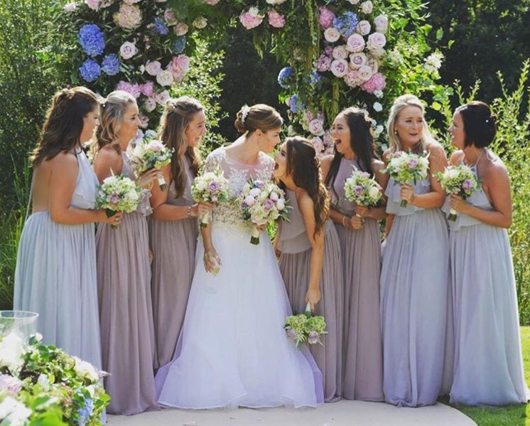 Incredible bride Laura and her bridesmaids who wore a mixture of Olympia in Smoked Orchid & Silvermist.