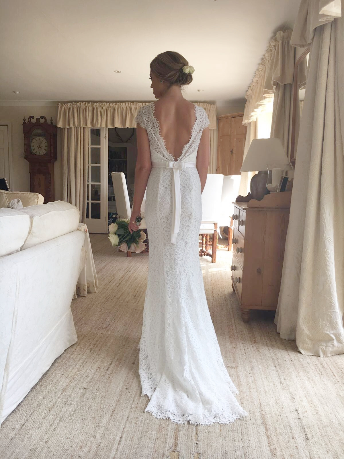 Stunning Ellie wears a TH&TH Privé cap sleeve gown in Ivory.