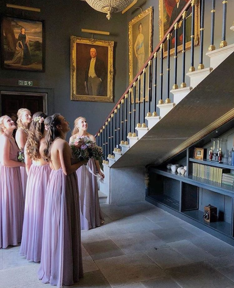 Olivia's bridesmaids awaiting her arrival wearing  Olympia gown in Smoked Orchid .