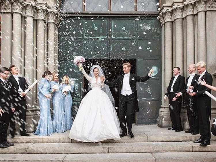 Magdalena in the most epic exit, alongside her bridesmaids wearing Alara in Bluebird - Photo  Anna Lauridsen