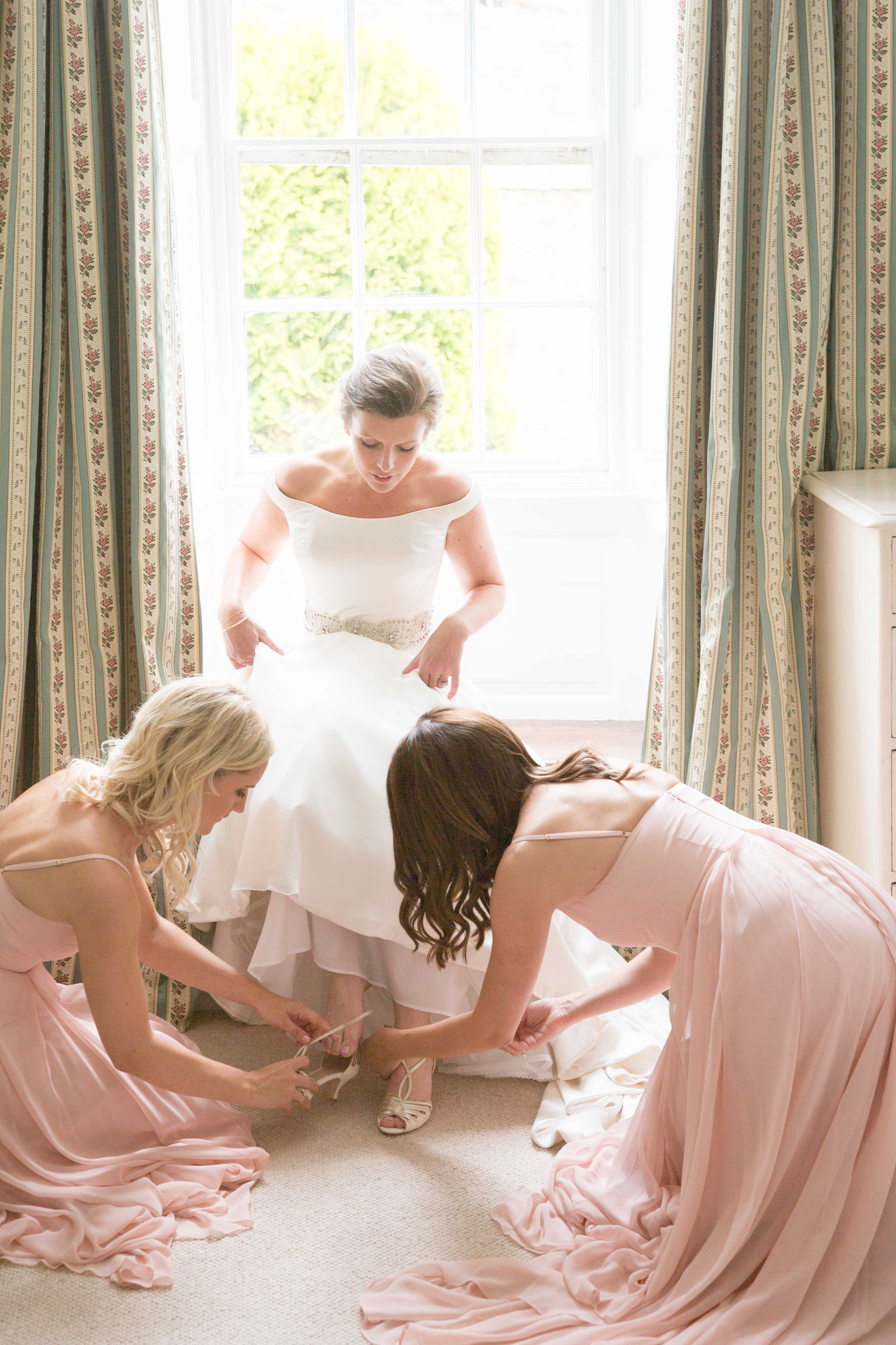 Sophie's best girls making the final preparations wearing Edie in Blush - Photo  Lucy Tanner