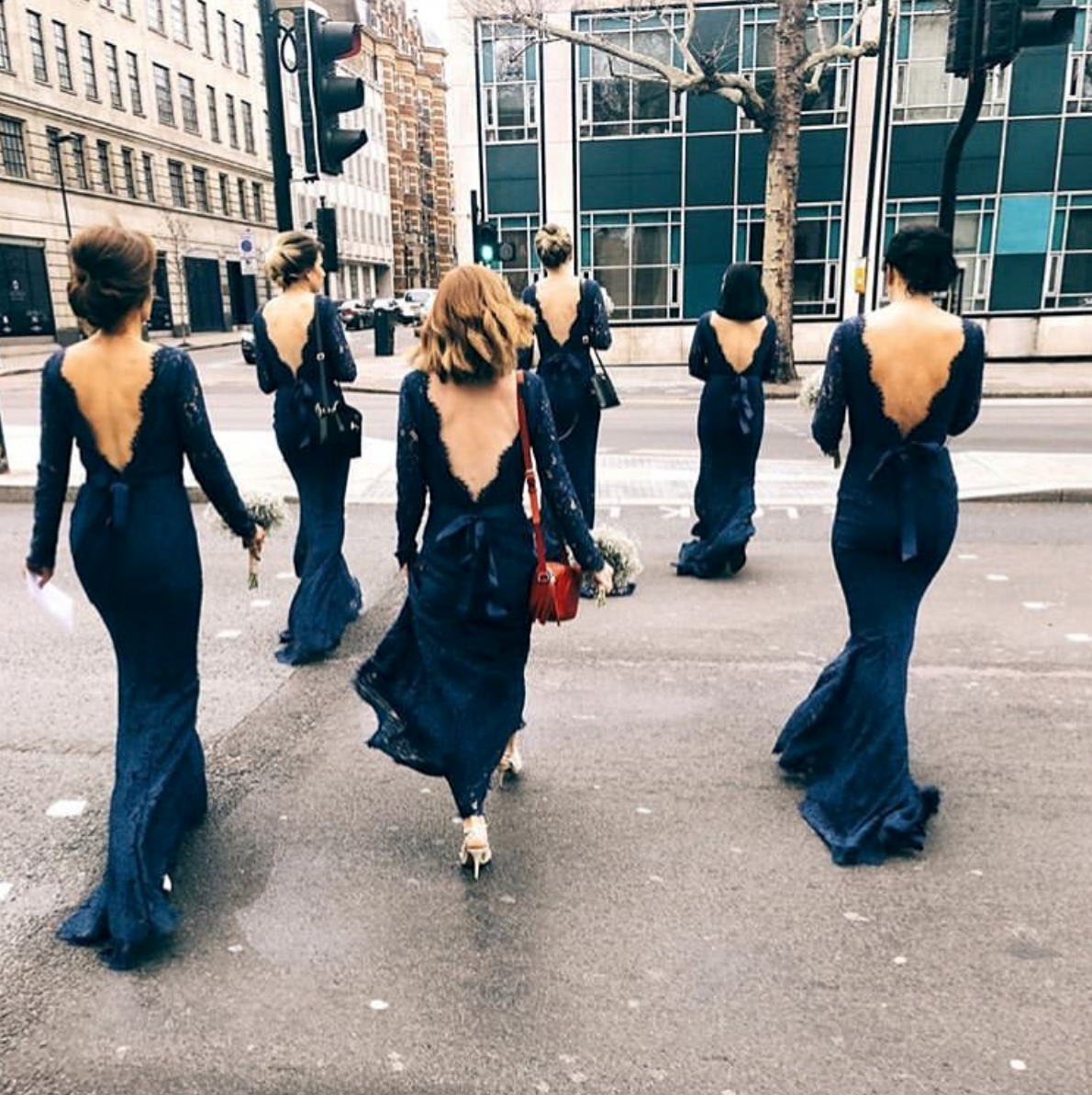 The ultimate gown gang wearing Alara in Navy.