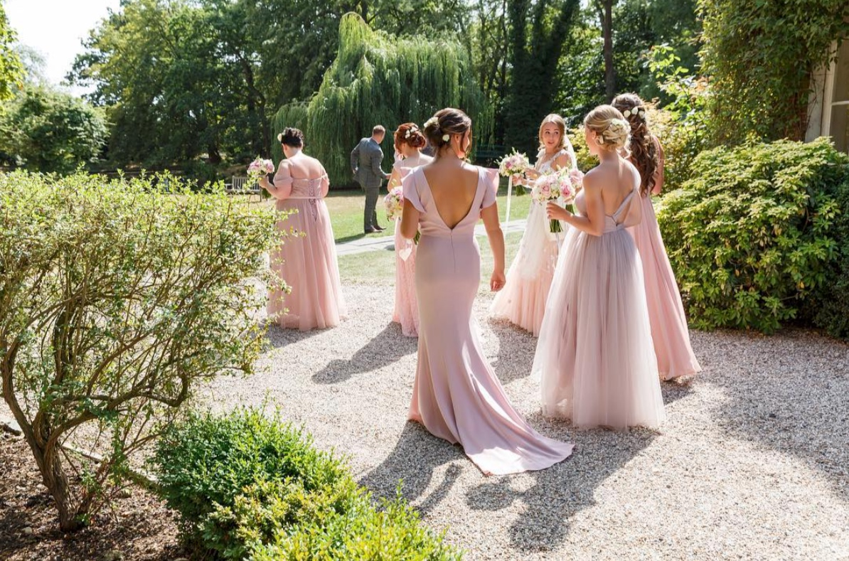 Leading ladies in a mix of TH&TH gowns for Amy's wedding - Photo  Gavin Woollard Photography