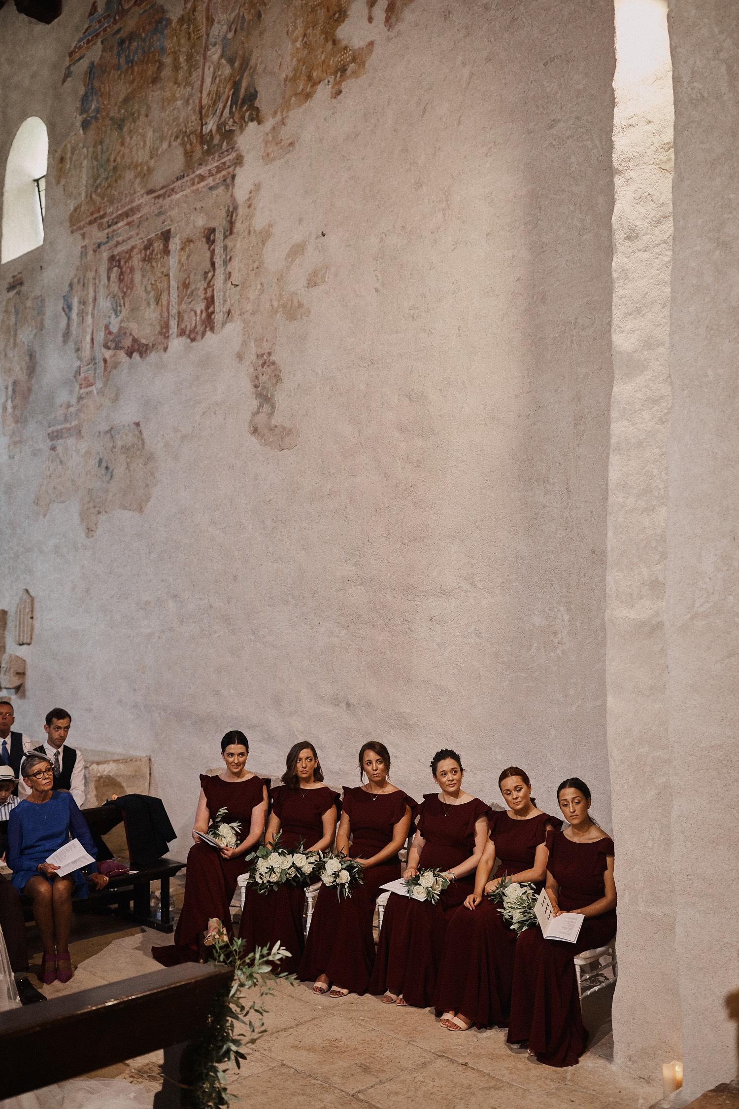 Beautiful bridesmaids all in a row, wearing Cecelia Roseberry - Photo Benjamin Wheeler