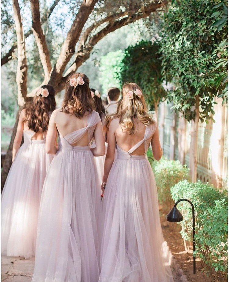 Alice's bridesmaids making their way to the aisle in Luna Smoked Orchid - Photo Maria Rao