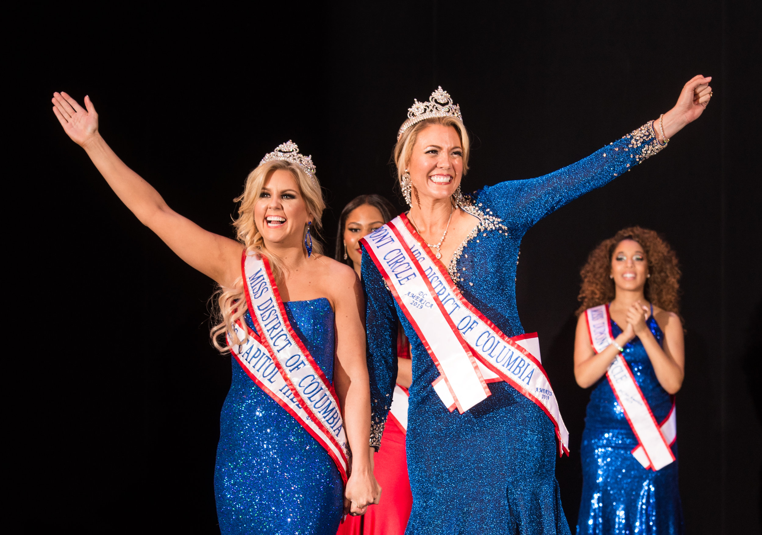 Megan Eunpu and Nikki Noya wave to the crowd after being crowned Miss DC for America and Mrs. DC America, respectivly.
