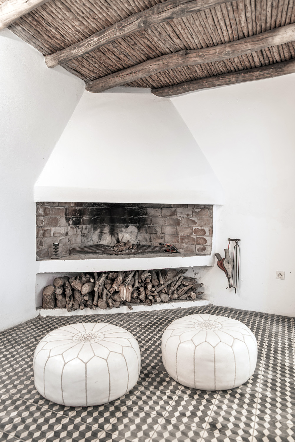 Fire place with moroccan poufs