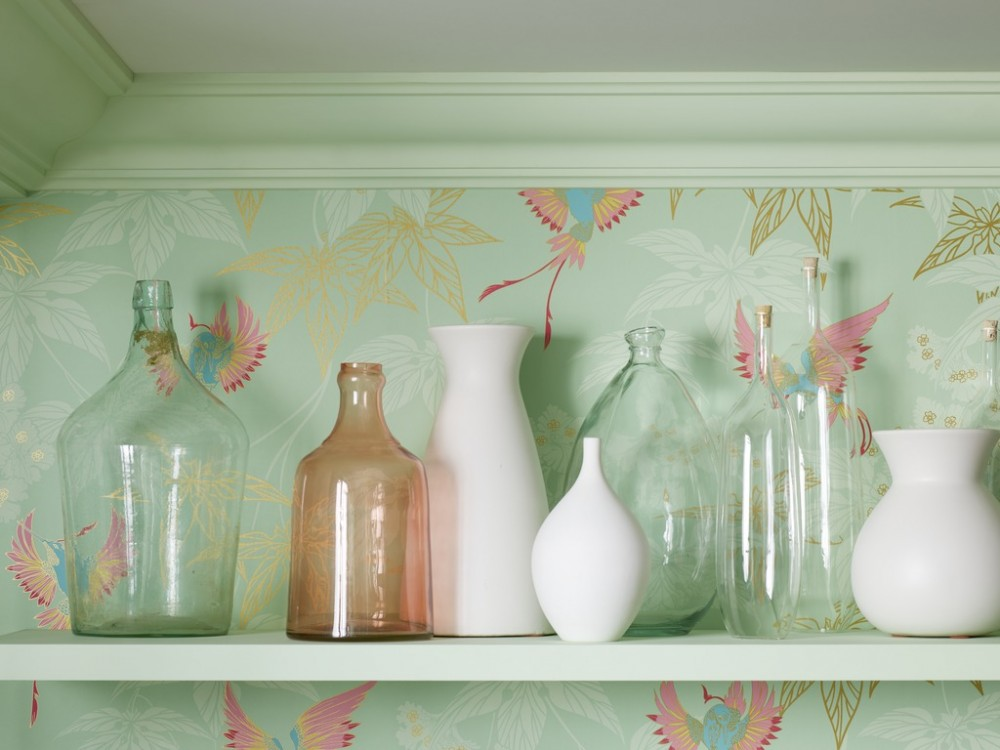 Keep accessories simple against an intricately patterned wall.