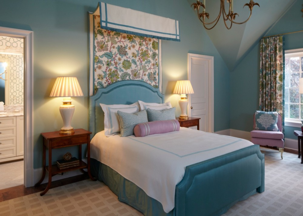 To emphasize a grand ceiling height, designers incorporated rich fabrics into their tasteful, confident guest bedroom design.