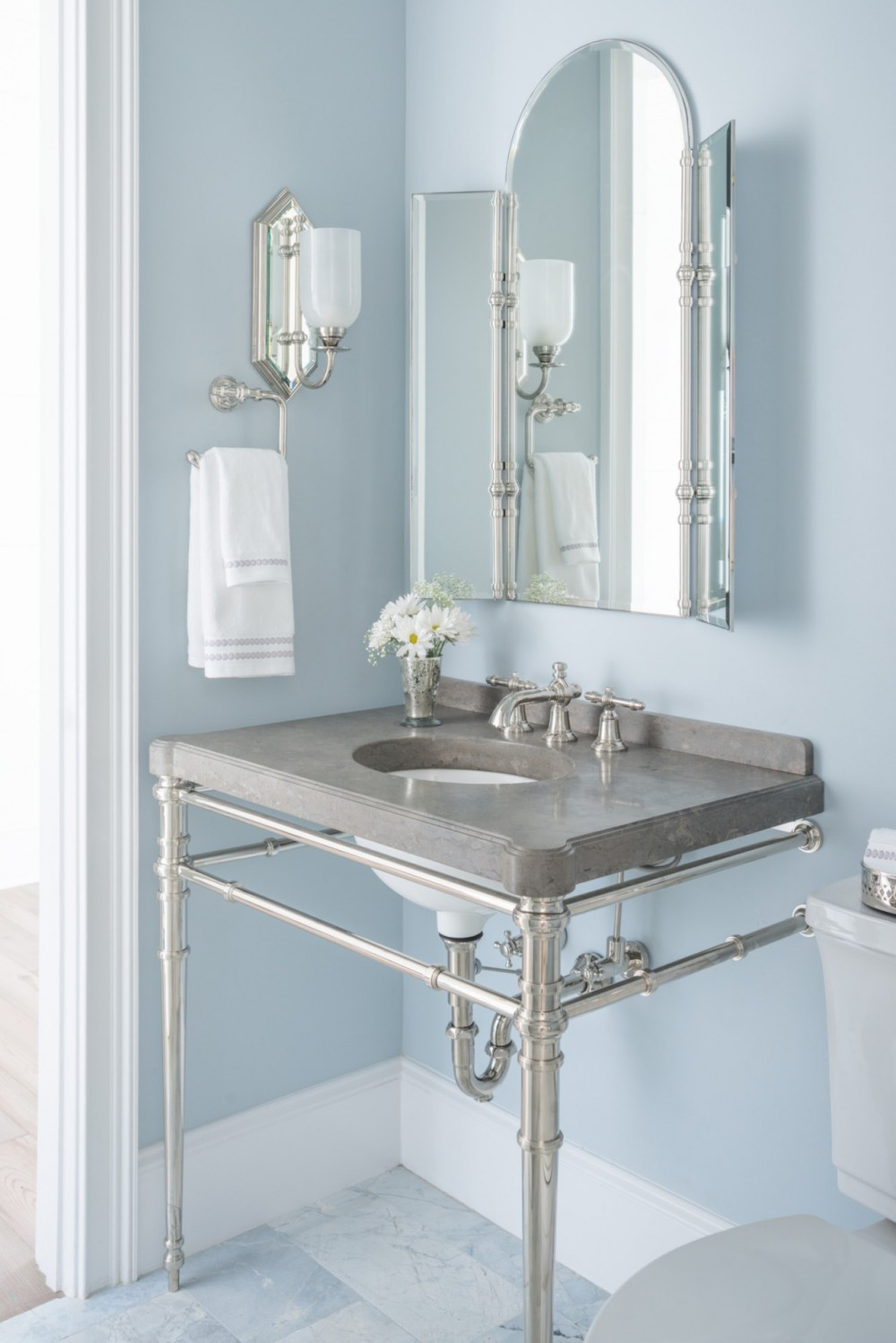 The powder room shows off a side of Southern style that's steeped in elegance and tradition.