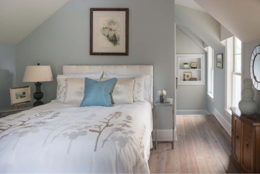 The carriage house suite serves as welcoming guest quarters, with its soft colors and cozy, coved ceiling.