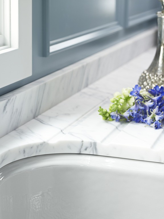 The Ice Grey Hartland sink color coordinates beautifully with cool marble countertops.