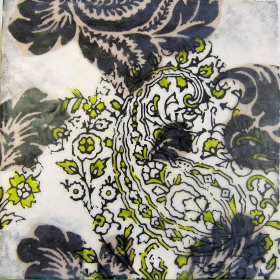 The paisley design is printed on the surface, then painted with oils and fused with a layer of encaustic medium and heat.