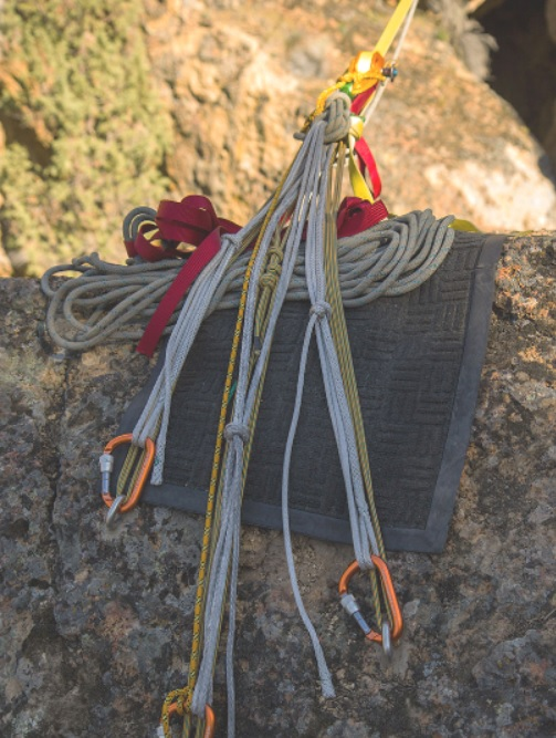 Main anchor built with 5 mm TechCord (yellow/blue rope) with Amsteel (gray rope) bolt-isolation backups. Notice the aluminum carabiners only connected to the backup. These will only be loaded in the event of a main failure.
