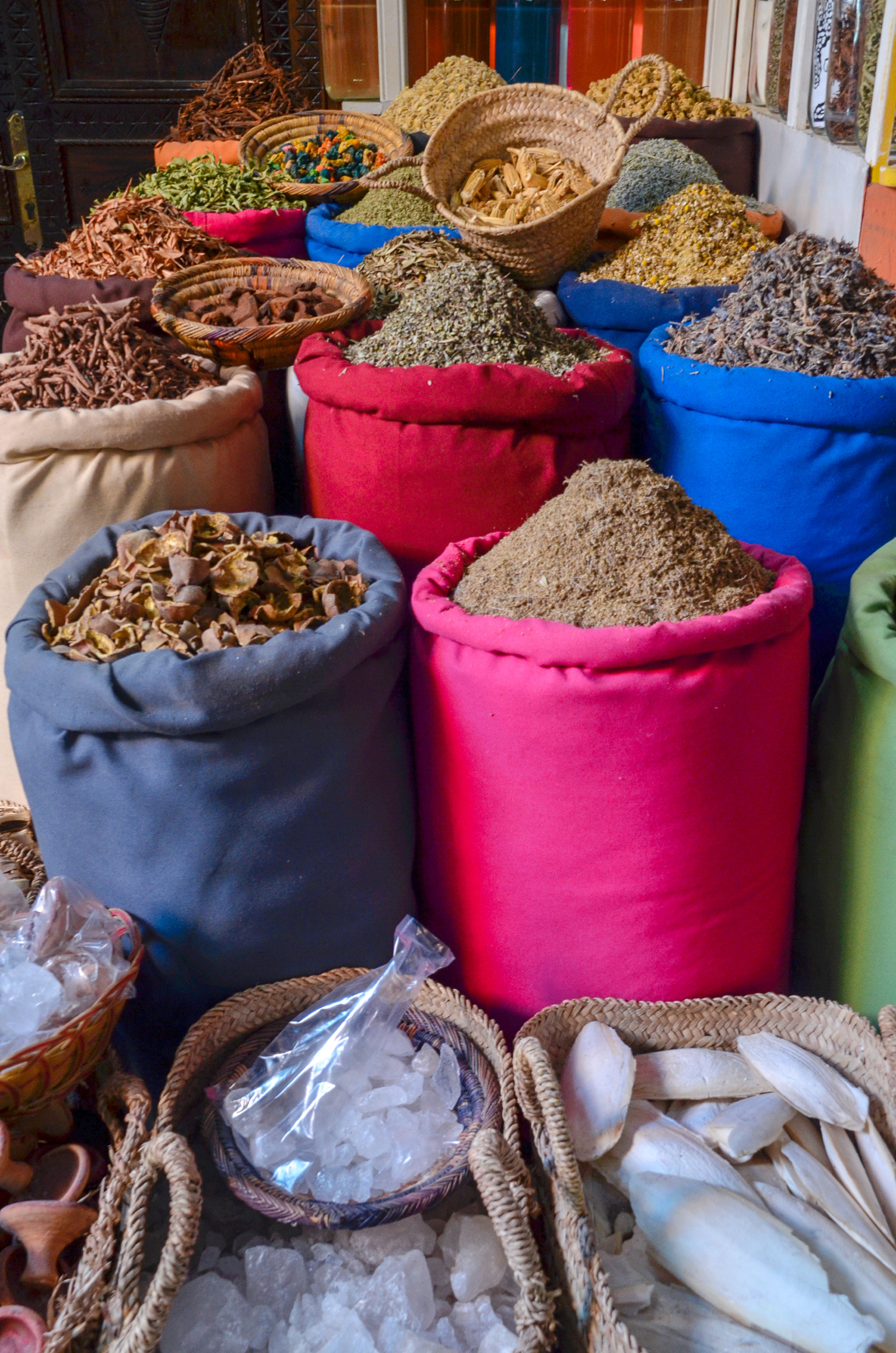 A mixture of dried teas and spices alongside with crystals