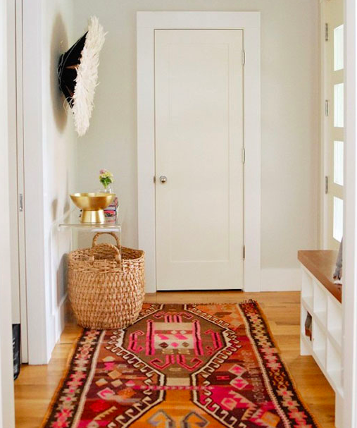 Credit: theeverygirl.com   Rug can also bring a pop of color to your decor.Active rooms like dining rooms , hallways or foyer can benefit more from dynamic colors. People circulate through the space and the movement can be expressed with a dynamic color.