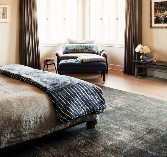 Credit: Domaine Home  A neutral rug forms a solid foundation when you want to layer on rich textures, patterns or colors. Think of it as the canvas for the rest of your room.