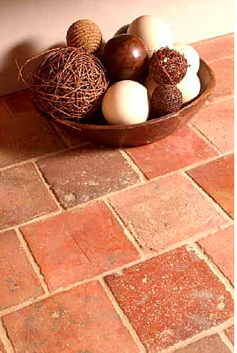 Traditional ceramic tile can be naturally colored and left unglazed like terra cotta.