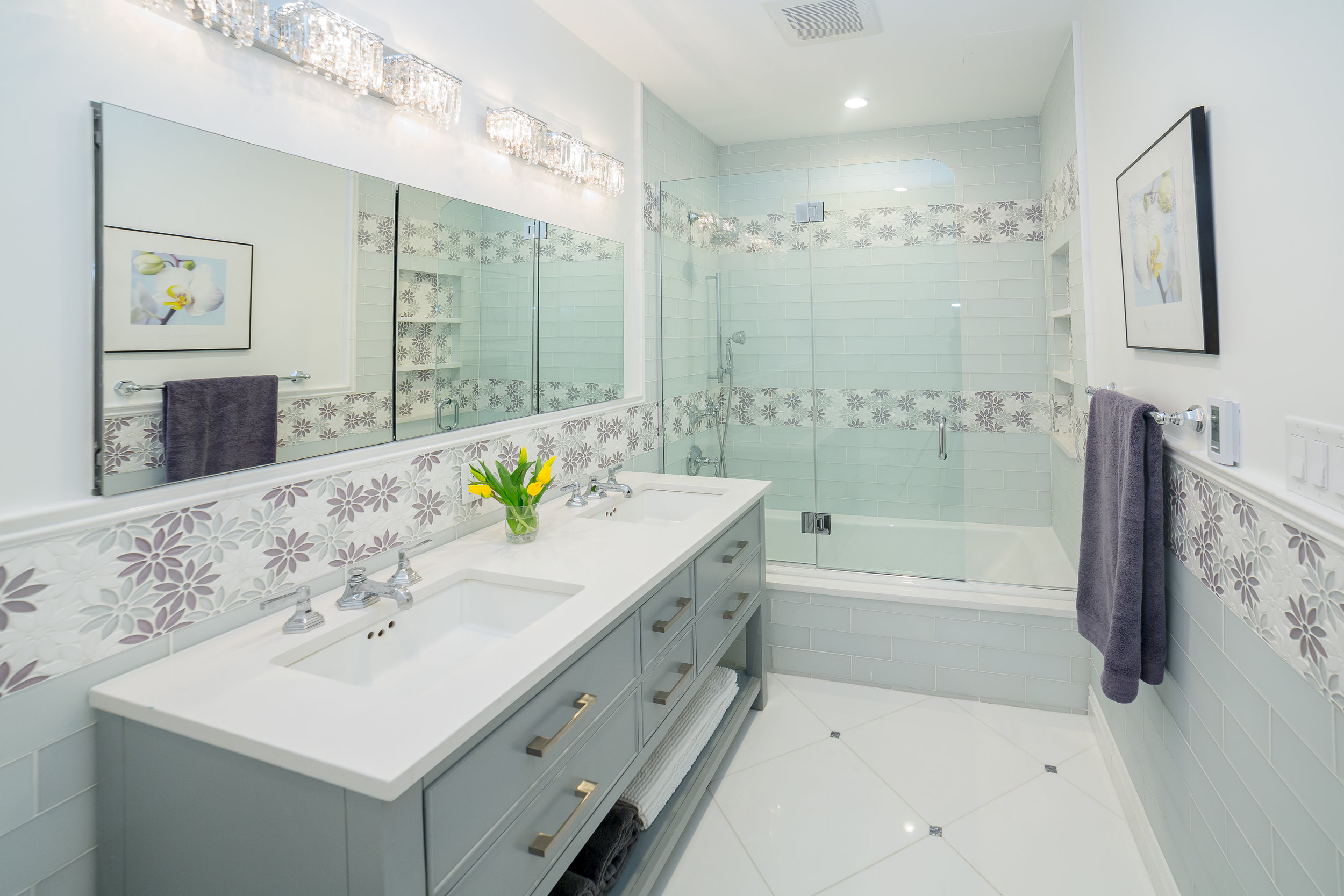 Designed by Marie Burgos Design - Photo Credit Francis Augustine   Floor Tiles: Thassos Marble - Floor Accent Tile: Seashell Blocking mosaic - Accent Tiles: Gardenia Calliope Thassos and Glass Tile from  Tile Bar