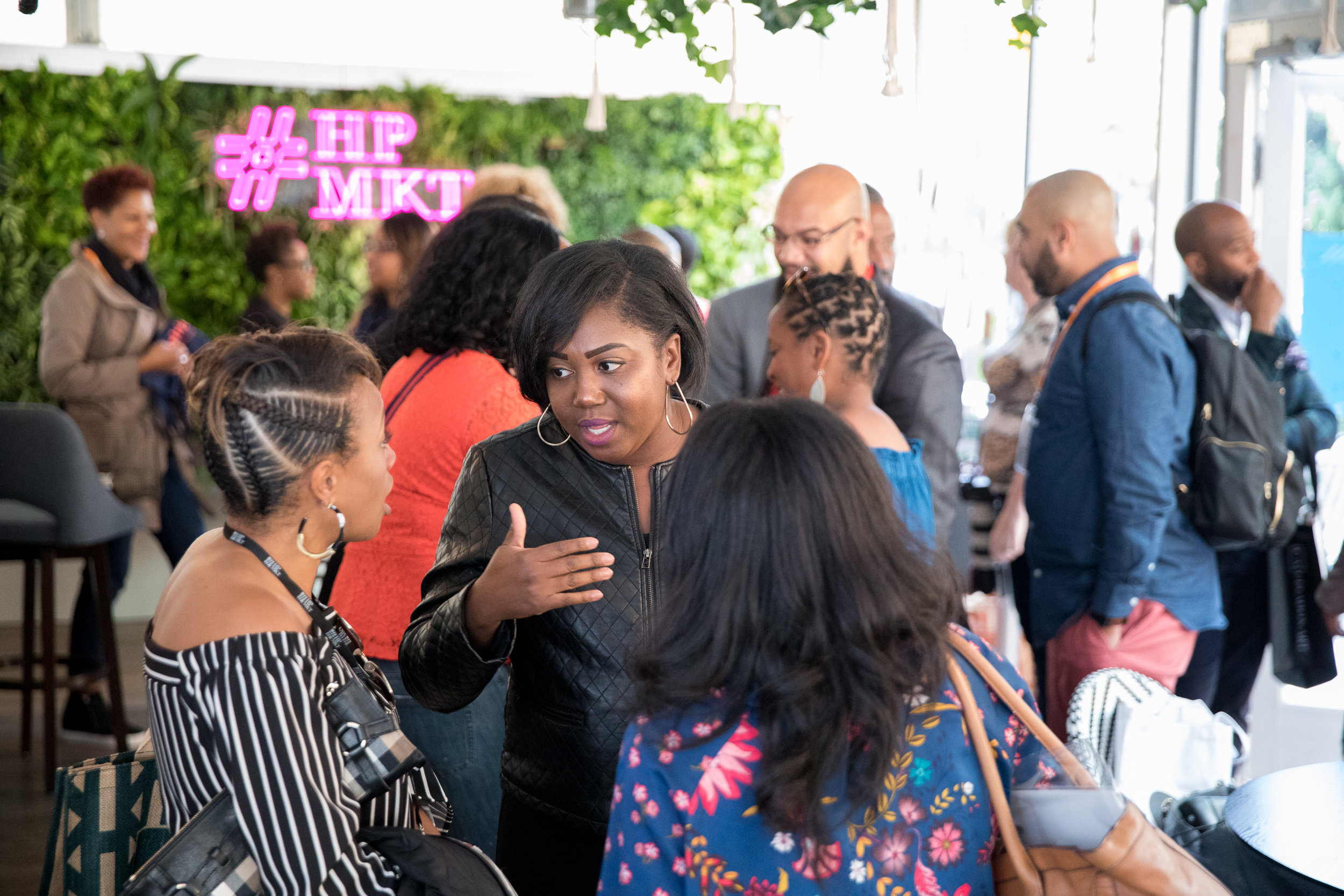 The Point is a new gathering venue at High Point Market. Many events and cocktail parties happen here. This image, courtesy of High Point Market is from a Black Interior Designers Network meet and greet.