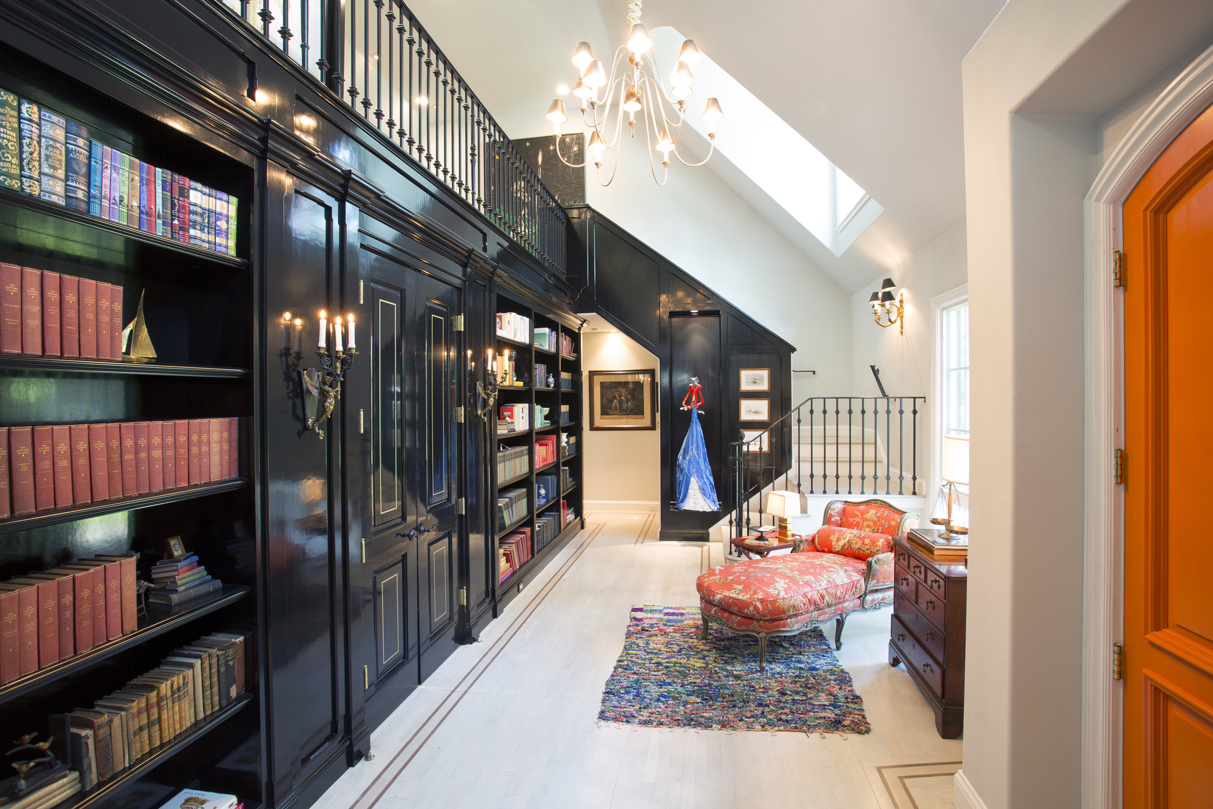 Lacquered woodwork lines the entrance of a California home .  Photo: Gregory Zabilski