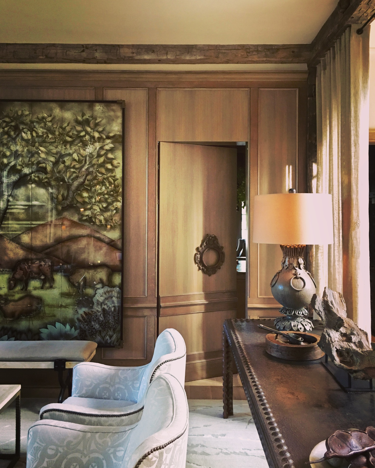 The Foliage Table lamp (available through Arteriors) was based on two antique lamps Barry bought in France.