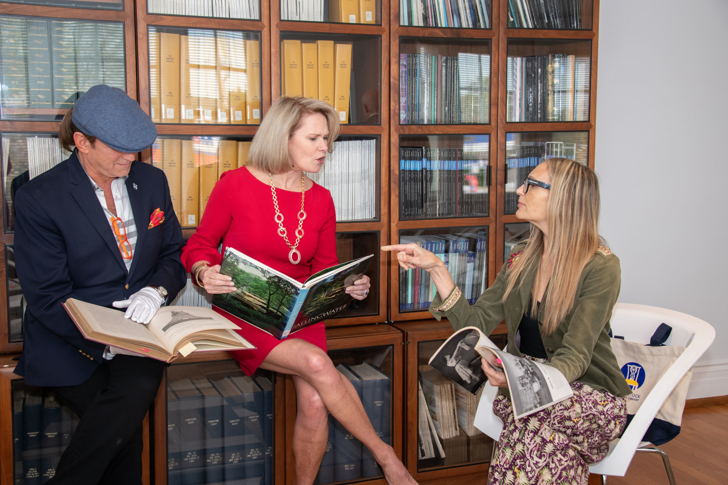 At the Bienenstock Library,. Libby's acting skills come in handy. Gary is wearing cotton gloves in order to handle a rare antiquarian book. Image:  MaryAnn Luedtke Photography