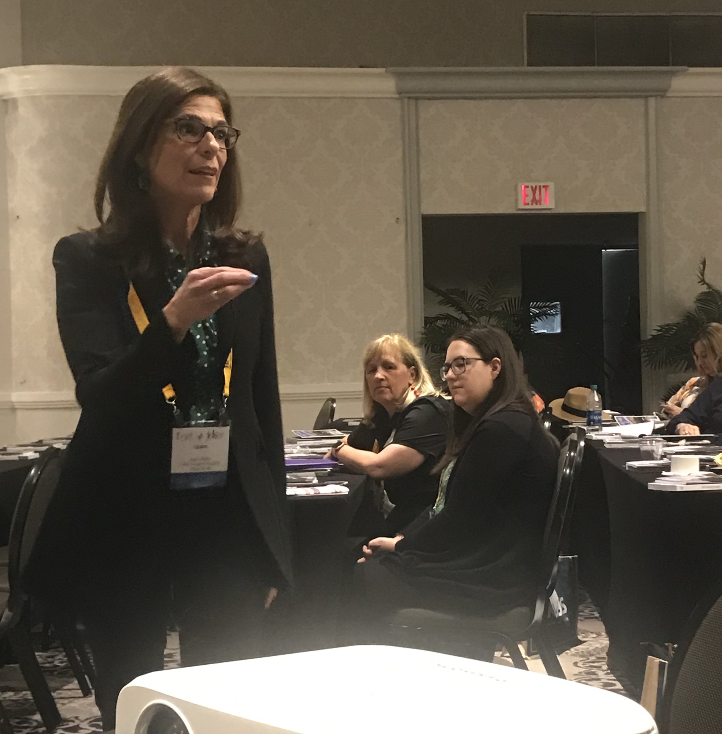 """LuAnn Nigara distributed copies of her books to all attendees. She said, """"After 450 interviews, I am just getting how you are doing business and no one does it alike."""" She urged designers to be upfront with clients from the start and to not be afraid of feedback at the end."""